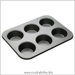 Bakeware Large 6 Hole Muffin Pan. Derived work from original images, © Thomas Plant 2006 and prior, used with permission.