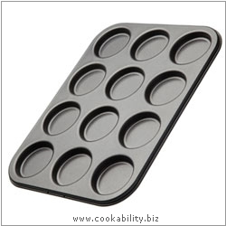 Bakeware Whoppie Macaroon Pan. Derived work from original images, © Thomas Plant 2006 and prior, used with permission.
